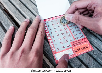 Brighton, England-1 October,2018: Student or tourism scratching seven day bus pass ticket for public bus in Brighton & Hove route.