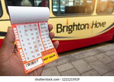 Brighton, England-1 October,2018: Student or tourism holding the Brighton & Hove seven day saver bus pass ticket inside the public bus route.