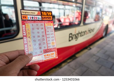 Brighton, England-1 October,2018: Student or tourism holding the Brighton&Hove seven day saver bus pass ticket inside the public bus route.