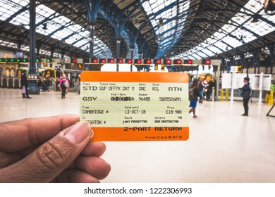 Brighton, England-18 October,2018: Hand holding a UK train ticket at Brighton & Hove train station for background in Brighton, England.