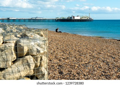 Brighton, England-19 October,2018: Beach view of Brighton Pier the nature public place with breakwater rock in the central at Brighton and Hove, England.