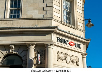Brighton, England-6 October,2018: HSBC Bank sign in the entrance of the HSBC bank branch office in the city town of Brighton, UK with beautiful old vintage building.