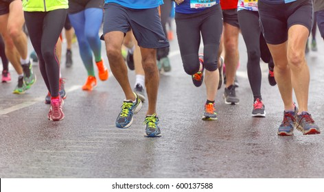 BRIGHTON, GREAT BRITAIN - FEB 26, 2017: Group of colorful running feet and legs, some out of focus in the Vitality Brighton half marathon competition. February 26, 2017 in Brighton, Great Britain