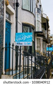 Brighton and Hove, East Sussex, England March 4th 2018,  Georgian style flats for sale with Brand Vaughan sign showing they are for sale  in Grand Parade Brighton