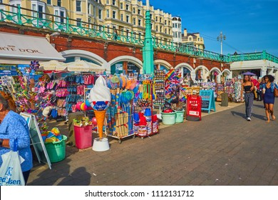 Brighton and Hove, East Sussex, England, UK June 13th 2018 Brighton beach attractions and many people enjoying the beach shops, bars, restaurants and rides and art shops