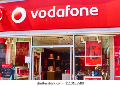 Brighton and Hove, East Sussex, England June 1st 2018 the exterior of the Vodafone shop in bright red, the mobile phone company's signature colour