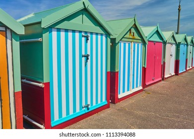 Brighton and Hove, East Sussex, England June 15th 2018  Beach huts in vibrant colours line the promenade in Hove Lawns, Brighton Beach , UK. Beach huts are highly desired