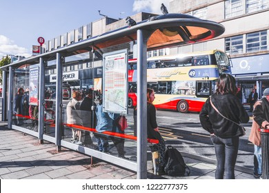 Brighton and Hove East Sussex, England-12 October,2018: Main bus stop station in Churchill Square Brighton with board map direction for passenger and passenger waiting for the bus.