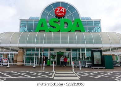 Brighton and Hove Brighton, England-2 October,2018: ASDA big supermarket shopfront entrance with local people and cart parking in front the supermarket.