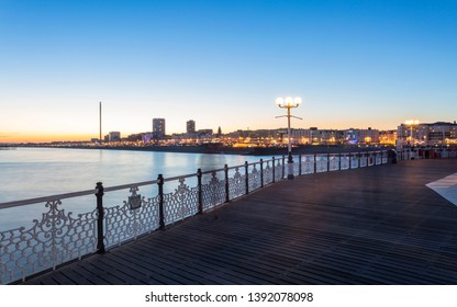 Brighton and Hove from Palace Pier at dusk, East Sussex, England, United Kingdom, Europe