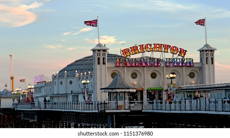 Brighton and Hove, Sussex, UK, July 2018. Brighton Palace Pier in the warm light of sunset. The pleasure pier is a Grade 2 listed pier on the south coast of England that first opened in 1899.