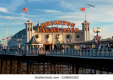 Brighton and Hove, Sussex, UK, March 2018. The Brighton Palace Pier at sunset. The pier has been given a new name in 2018 and is a Grade 2 listed pleasure pier in England that first opened in 1899.