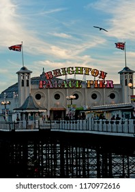 Brighton and Hove, UK, March 2018. The recently renamed Brighton Palace Pier at the seaside of Brighton and Hove is lit up at sunset. It is one of the U.K.'s most popular tourist attractions.