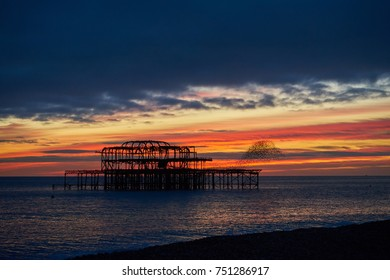 Brighton and Hove West Pier at Sunset, with hundreds of Starlings flying in formation        - Shutterstock ID 751286917