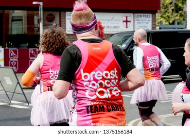 Brighton Marathon, Brighton and Hove, England, April 2019. Runners in the Brighton Marathon, many of whom dressed up in colourful costumes to raise money for worthwhile causes like breast cancer care.