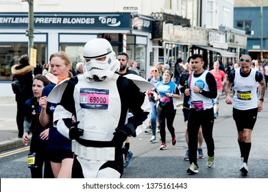 Brighton Marathon, Brighton and Hove, England, April 2019. Runners in the Brighton Marathon including one dressed up in a Star Wars costume, many of whom are raising money for worthwhile causes.