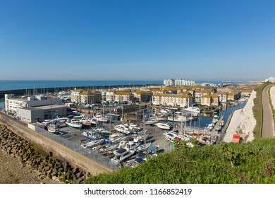 Brighton marina boats and yachts and apartments on a beautiful day in East Sussex England UK