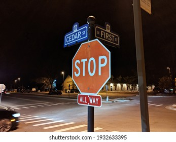 Brighton, Michigan, United States - March 8, 2021: A Stop Sign At Cedar Street and North First Street in Downtown Brighton MI, Road Intersection