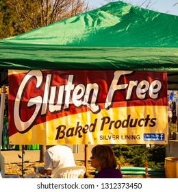Brighton, Michigan / USA - May 2 2015: A tent sign advertising gluten free products at outdoor market area.