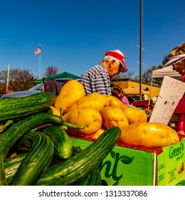 Brighton, Michigan / USA - May 2 2015: An outdoor market vendor at his booth of fresh garden produce.