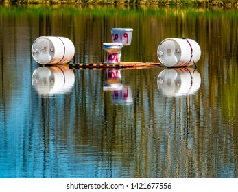 Brighton, Michigan / USA - May 5 2019: A balanced floating toilet on a pond as a student project prank.