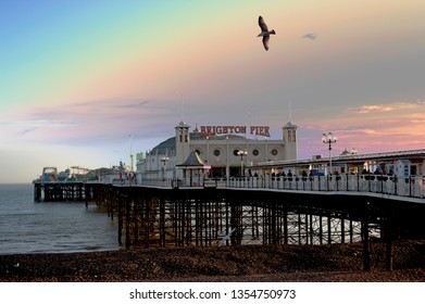 Brighton Pier, Brighton and Hove, Sussex, UK, March 2018. Brighton Pier in Brighton and Hove, with a sky enhanced by photoshop fx, is one of the U.K.'s most popular tourist attractions.
