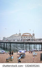 Brighton, Sussex / United Kingdom - July 08 2018: Brighton Pier during hot summer in July with clear blue sky.