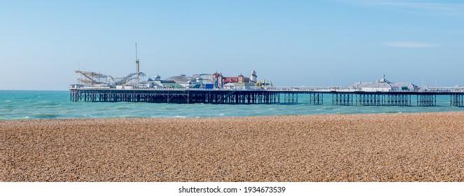 Brighton, UK, February 2021. Brighton Pier from the beach