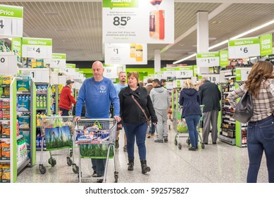 Brighton, UK, - February 25, 2017. People shopping in Asda supermarket, one of the biggest chains of supermarkets in United Kingdom.