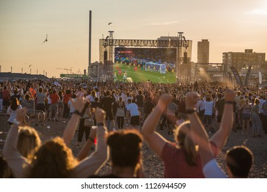 Brighton, UK, July 3rd, 2018.  World Cup football fans attending the England vs Columbia game, live, on a giant screen by the beach