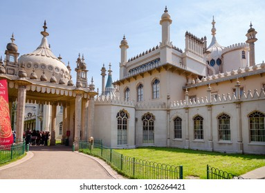 BRIGHTON, UK - JUN 5, 2013: Visitors at the entrance to the Royal Pavilion (Brighton Pavilion), former royal residence built in the Indo-Saracenic style in Brighton, East Sussex, Southern England, UK