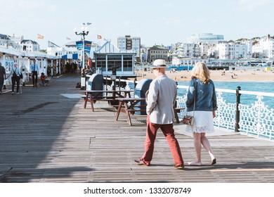 BRIGHTON / UK - June 22, 2018: Brighton Pier with people walking on it