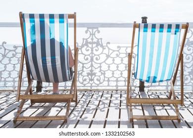 BRIGHTON / UK - June 22, 2018: Two chaiselongues on Brighton pier