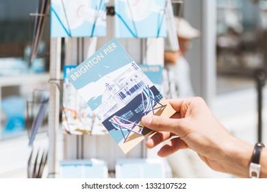 BRIGHTON / UK - June 22, 2018: A hand holding a vintage postcard of Brighton