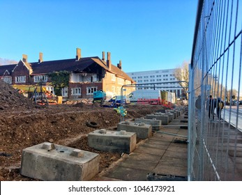 Brighton UK, March 2018 land being filled on developing site Moulsecoomb, Lewes road. Picture includes an old army barrack and piles of earth.  Industrial building site land development