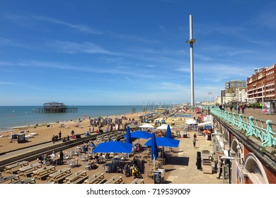 BRIGHTON, UK – MAY 21, 2017: In Brighton, England, the British Airways i360, the world's tallest moving observation tower, rises up over the pebble beach and burned out ruins of Brighton West Pier.