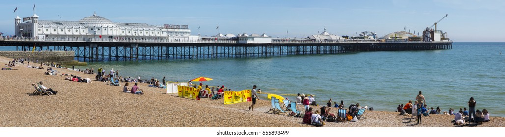 BRIGHTON, UK - MAY 31ST 2017: A view of the famous Brighton Pier and seafront in Sussex, UK, on 31st May 2017.