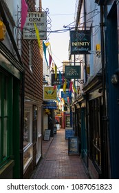 BRIGHTON, UK - MAY 4TH 2018: A view down one of the narrow streets of The Lanes in the historic quarter of the city of Brighton in Sussex, UK, on 4th May 2018.