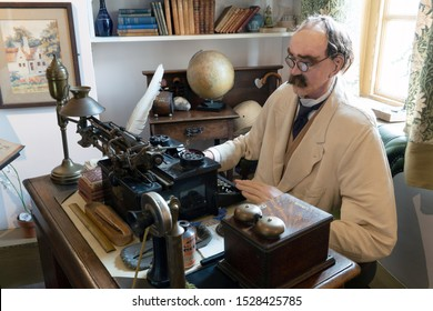 Brighton, United Kingdom - 8 October 2019: Model or wax work of Joseph Rudyard Kipling in his office at the Grange Museum Rottingdean, Brighton UK.