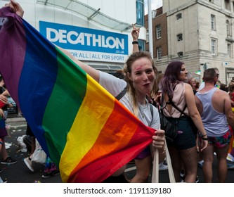 Brighton, United Kingdom - August 4, 2018; Brighton Pride Parade, walkers of the parade enjoying the festivities in bright costumes and colourful make up.
