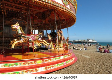 Brighton, United Kingdom - July 5, 2015: Brighton's carousel proves popular on a summer weekend. Brighton is one of the United Kingdom's most popular coastal destinations.