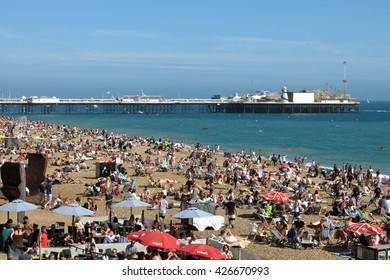 Brighton, United Kingdom - July 5, 2015: Brighton's pebbly beach draws crowds of sunbathers on a summer weekend.