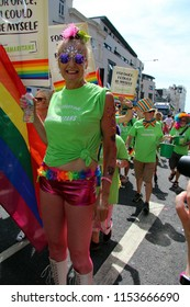 Brighton,East Sussex/UK 08-04-18 The Samaritans marching in Brighton's  Pride parade 2018 as it went up West Street in the city centre. Including this glamorous lady in hot pants and fishnets