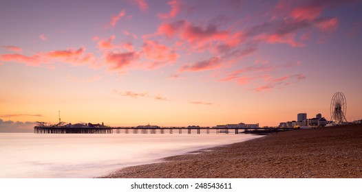 Brighton's seafront silhouetted against the sunset
