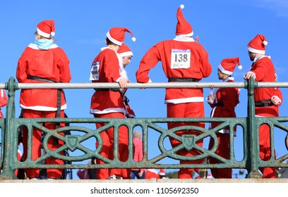 Brighton,Sussex,UK-December 12th 2015: Participants in the Santa Dash on Hove Seafront, Sussex,UK