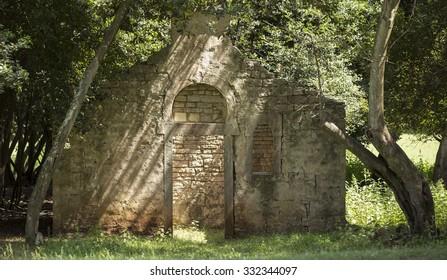 BRIJUNI, CROATIA - MAY 2015 - An old building under the shadows of trees at National Park Brijuni, in Croatia.