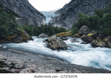 Briksdal or Briksdalsbreen glacier with melting blue ice, Norway nature landmark close-up view