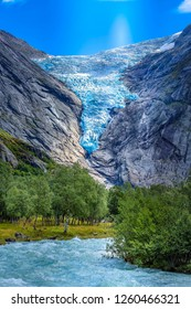Briksdal or Briksdalsbreen glacier with melting blue ice, Norway nature landmark and turquoise river