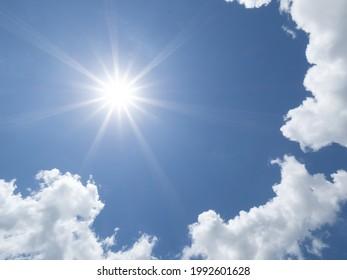 Brillant sun shining in blue sky overhead in southwest Florida USA