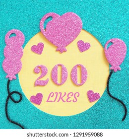 a brilliant banner for posting on a social network about 200 likes with balloons and hearts.